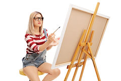 focused-woman-painting-canvas-paintbrush-isolated-white-background-70884206